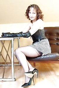 Kirsty Erotically Poses On The Small Table And Takes Her Skirt Above