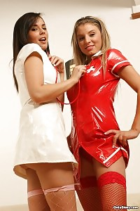 2 Girls In Latex Teasing And Dancing In Sexy Nurse Costumes